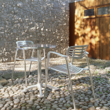 Toledo Stacking Chair and Pensi Round Table for indoor or outdoor use