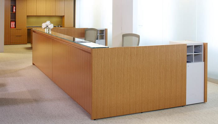 ... wood veneers and other surface materials to provide a flexible,  cost-effective alternative to custom millwork. Administrative and reception  workstations ...