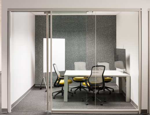 Knoll Reff Profiles meeting table and media enclave with grey and yellow ReGeneration ergonomic chairs