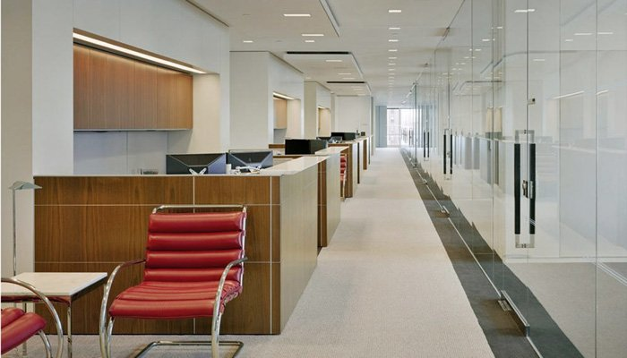 AutoStrada® workstations with transaction counters. MR Lounge Chair and Florence Knoll End Table in foreground