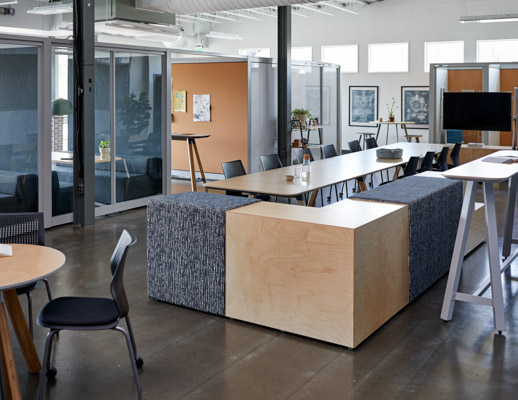 rockwell unscripted creative wall fixed fins glass fins booths banquettes private niche k. lounge cork library table multigeneration by knoll upholstered steps tall table drink rail upholstered seats round swivel stools hospitality team meeting