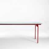 Antenna Workspaces Desk with glass top and red legs
