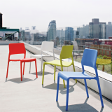 Spark Series stacking chairs by Don Chadwick in red, blue and green