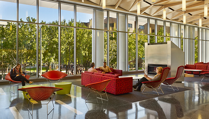 Residence hall community space with Bertoia Bird and Diamond Chairs, Maya Lin Stones and Pfister Sofas