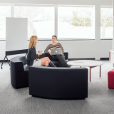 Knoll white Antenna low table with red legs, grey k. lounge and Interpole for Activity Spaces and other meeting spaces.