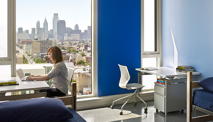 Residence hall room with Antenna® Desks and MultiGeneration by Knoll® Hybrid Base Chairs