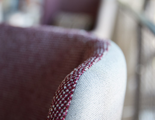 rockwell unscripted lounge highback chair split upholstery detail knolltextiles hourglass misty seurat circus