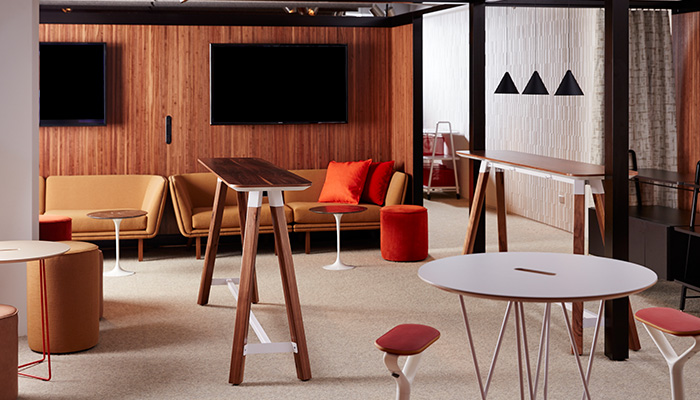 Rockwell Unscripted Creative Wall, lounge furniture, stools and tables.