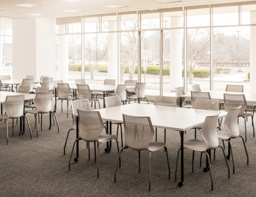 Knoll Antenna simple tables with black legs and MultiGeneration by Knoll chairs for a café