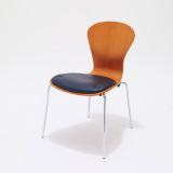 Sprite stackable chair with seat pad by Ross Lovegrove