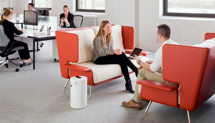 Community space with Architecture & Associes Settee, Antenna® Workspaces and ReGeneration by Knoll® Task Chairs