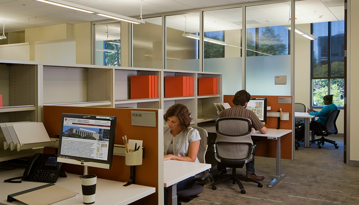 Shared open plan administrative area with Template® Storage and Generation by Knoll® Task Chairs