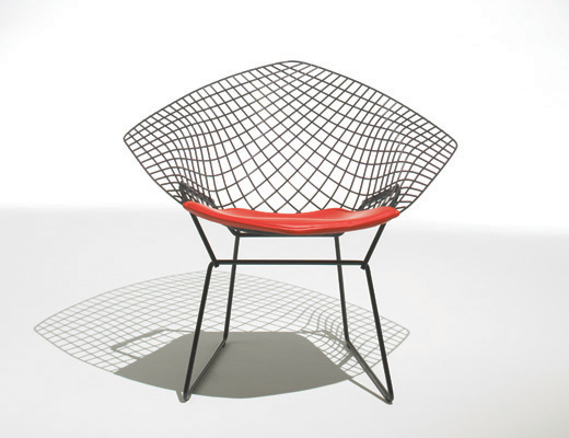 Harry Bertoia Diamond Chair in black with red seat pad