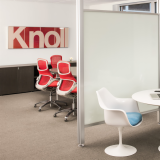 Knoll Activity Space with white Saarinen Tulip Table and arm chairs