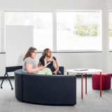 Knoll Interpole with grey k lounge and red Antenna Simple Table for Activity Spaces and other meeting spaces.
