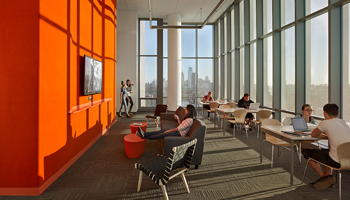 Informal student lounge area with Antenna® Tables, Maya Lin stones, Risom Lounge Chairs and Sprite Stacking Chairs