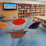Bertoia Diamond chair in red and yellow and Sprite chairs in library