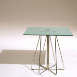 Paperclip Café Table with metallic grey legs and glass top