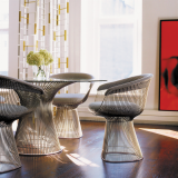 Platner Dining Table with polished nickel base and Platner Arm Chair