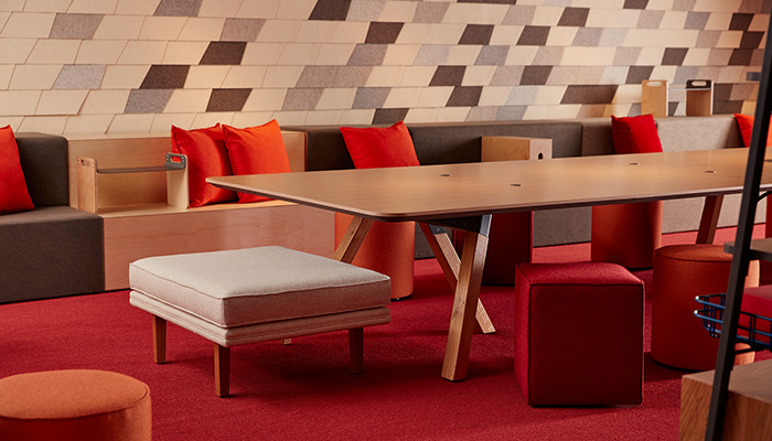 Rockwell Unscripted library table, steps and storage with FilzFelt ARO Collection acoustic wallcovering.