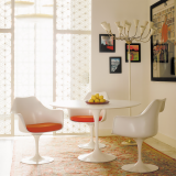 Saarinen Tulip Dining Table and Saarinen Tulip Chairs with Orange seat pads