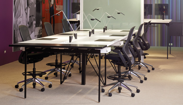 Antenna Workspaces Big Table, featuring new Sparrow™ LED lights, is a space efficient solution to a team work environment