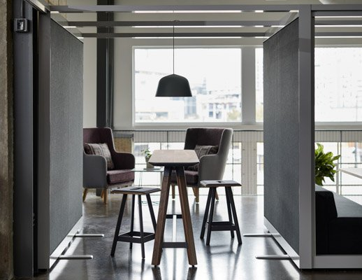 rockwell unscripted creative wall shared walls tall table drink rail counter height easy stools highback chair lounge muuto ambit pendant lamp lighting