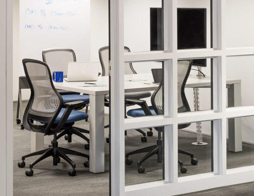 Knoll Reff Profiles meeting table and media enclave with blue ReGeneration ergonomic chairs