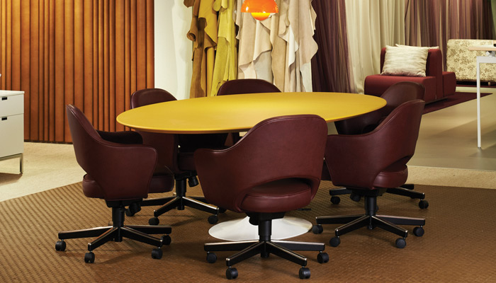 A classic Saarinen table with Spinneybeck leather wrapped top
