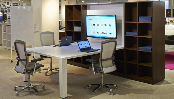 The combination of bookcases and new cabinets and worksurfaces creates a classic yet functional, modular meeting environment