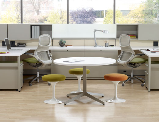 Dividends Horizon workstations with shared overhead storage and Generation chairs