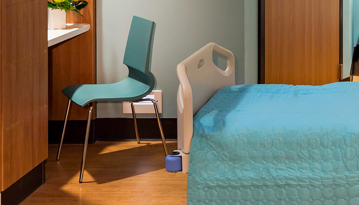 Patient room with Gigi® Guest Chair
