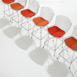 Bertoia barstools with red seat pad