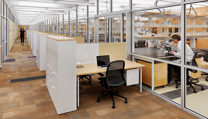 Research Lab with Chadwick High Task Chairs and administrative area in foreground with Antenna Workspaces® Stations, Template™ Storage and Chadwick® Task Chairs