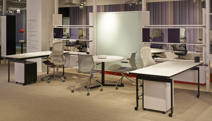 Antenna Workspaces Interpole Storage Wall defines space with open or enclosed cabinets