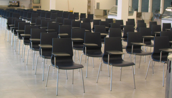 Flexible lecture area with Gigi® Stacking Chairs with Tablet Arms