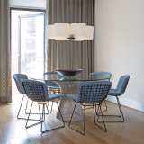 Platner Dining Table and Bertoia Side Chairs with blue seat covers