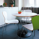 Cyclone Dining Table by Isamu Noguchi and white Sprite chair by Ross Lovegrove