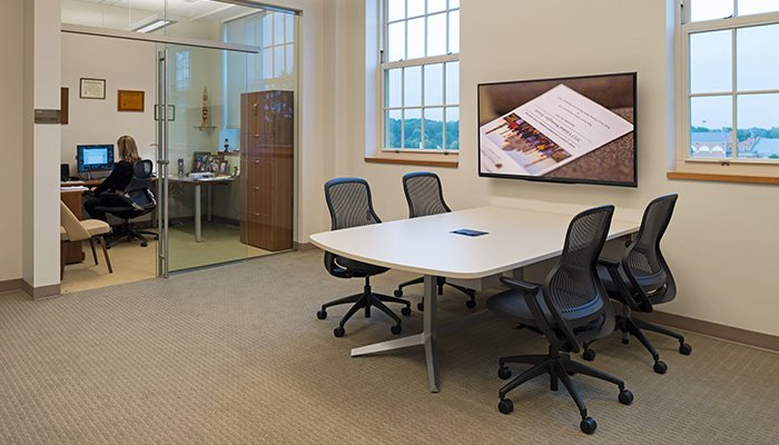 Administrative meeting space with shared Dividends Horizon® Media Enclave and ReGeneration by Knoll® Chairs