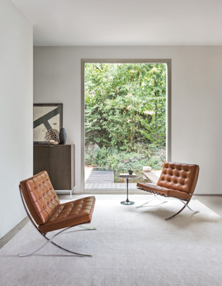 Lounge Area With Barcelona Chairs And Saarinen Side Table
