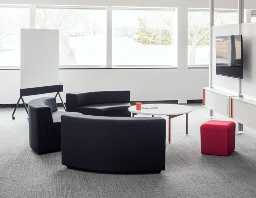 Knoll white Antenna low table with red legs, grey k. lounge and Interpole for Activity Spaces and other meeting spaces