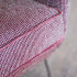 rockwell unscripted lounge seating club chair upholstered detail serged edge detail in red knolltextiles seurat circus