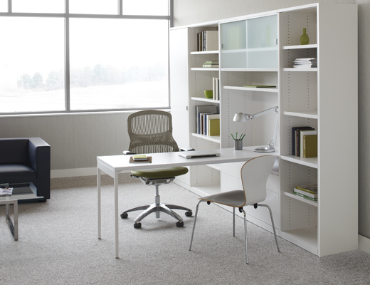 Template storage system puts the worksurface front and center, keeping active work visible and accessible.