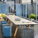 rockwell unscripted library table upholstered seats swivel stools steps laptop tray tall table drink rail creative wall filzfelt hanging panels fixed fins glass assembly community immersive open room  muuto fiber side chair hospitality team meeting