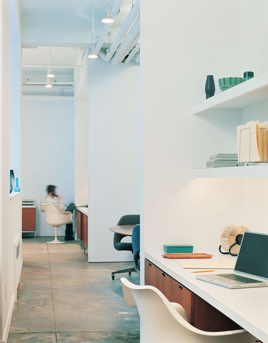 Chelsea Loft by Messana O'Rorke   PC: Elizabeth Felicella / Esto Photographics   Featured: Saarinen Tulip Chair, Executive Armless Chair with Swivel Base, Florence Knoll Table Desk