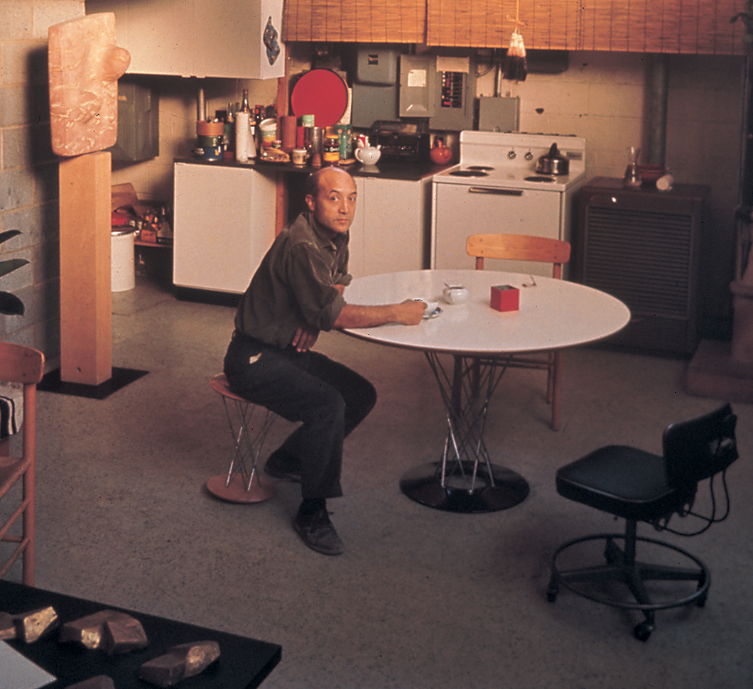 Isamu Noguchi seated at Cyclone™ Dining Table | Knoll Inspiration