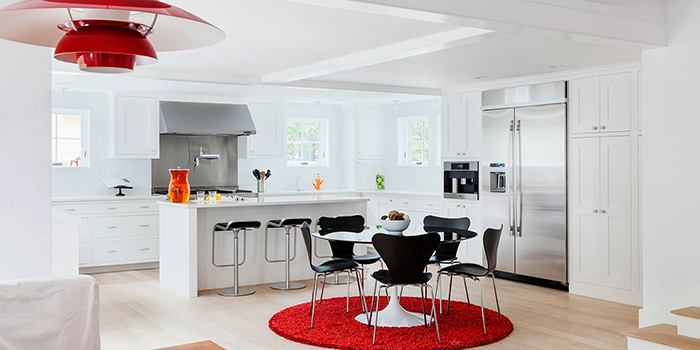 Kitchen in Lexington, MA features Saarinen's Dining Table, designed by Sally DeGan of SpaceCraft Architecture