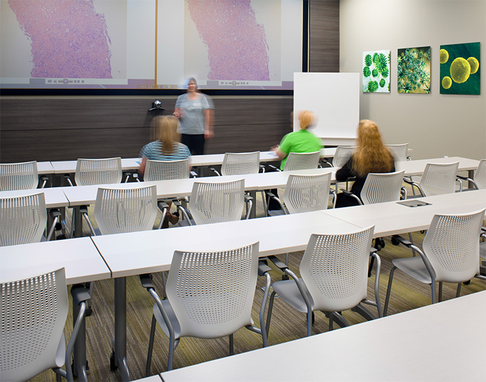 A training and classroom space invites staff and visitors to gather for lectures and discussion. Featured:MultiGeneration by Knoll<sup>®</sup> Stacking Chairs, Scribe<sup>®</sup> Mobile Markerboard