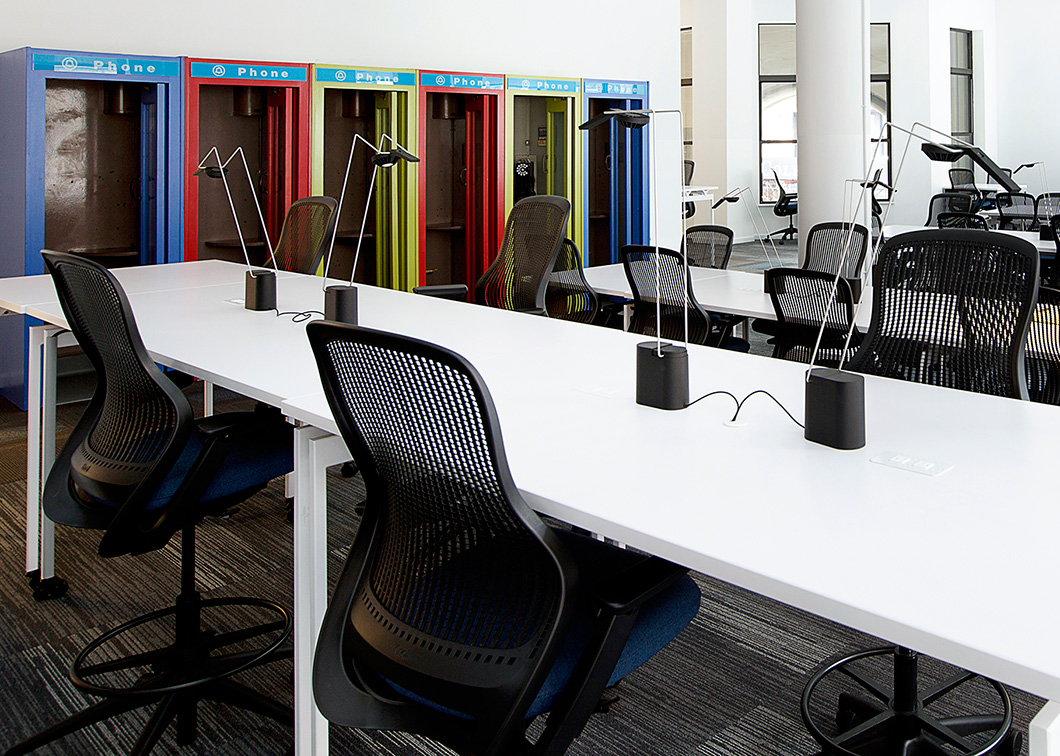 Bright white tabletops enhance the spacious feeling experienced with the building's open layout, white walls, high ceilings and generous natural daylight. | Featured: ReGeneration by Knoll Work and High Task Chairs, Antenna Workspace Tables, Sparrow Desktop Lights